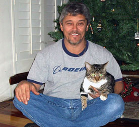 man sitting with cat